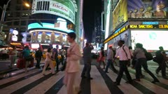 Times Square at night peple walking crossing street neon signs slow motion 24P Stock Footage