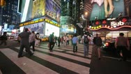 Stock Video Footage of Times Square at night peple walking crossing street neon signs 60P