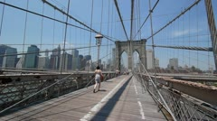 Brooklyn Bridge walking steadicam 60P New York City Manhattan skyline - stock footage