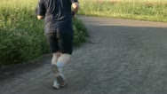 Stock Video Footage of Jogging and riding on bike in the park