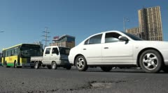 Traffic drives by in Urumqi Stock Footage