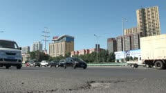 Time lapse video of traffic going by in Urumqi, China Stock Footage