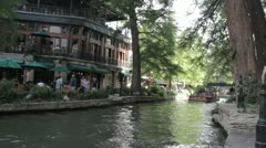 Stock Footage - San Antonio Texas - River Walk - Boat - Tourists - Wave Stock Footage