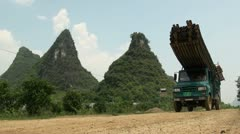 Driving a truck with rafts to the start of a tourist attraction in China Stock Footage