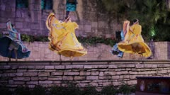 Stock Footage -  Mexican Dancers in dresses, tourist boat passes slowly. Stock Footage