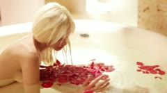 Beautiful girl hotel suite bath roses luxury Stock Footage