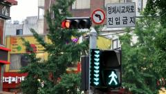 Traffic lights and crosswalk sign in downtown Seoul Stock Footage