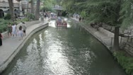 Stock Video Footage of Stock Footage - River Boat Passes Under Bridge - Tourists Wave - Overhead shot