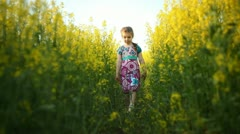 Baby in the flowers. walking Stock Footage