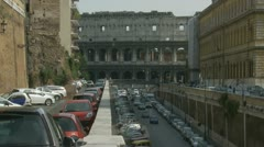 Busy traffic & side Colloseum (zoom out) Stock Footage