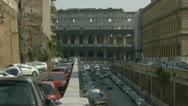 Stock Video Footage of Busy traffic & side Colloseum (zoom out)