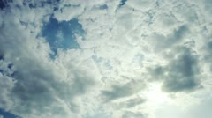 Blue Sky .. White and dark Clounds, and Bright Sun before Storm Stock Footage