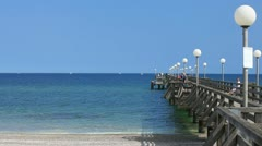 View of the sea bridge of Heiligendamm with people Stock Footage