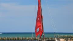 Catamaran on the beach of the Baltic Sea Stock Footage