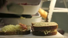 Bacon and cheese sandwich being made in an eatery Stock Footage