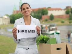 "Happy jobless businesswoman holding paper sheet with ""HIRE ME"" sign NTSC Stock Footage"