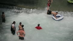 Stock Footage - People on the water fall - Jumping into inner tube - stock footage