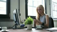 Businesswoman with cellphone sending a text message, dolly shot Stock Footage