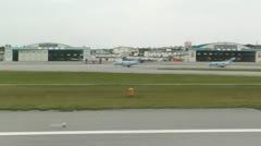 Landing Okinawa Naha Airport 02 handheld Stock Footage