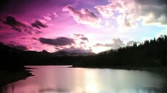 Time lapse Sunset Reflection Lake & Rockies #6 Stock Footage