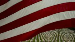 American Flag Flying Over Military Cemetery Stock Footage