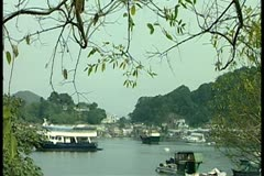 Boats on river 1 by DJM Stock Footage