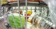 4K 30p At the grocery store behind the cart time lapse Stock Footage