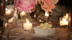 Fancy table set for banquet butter balls and candles Stock Footage
