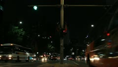 Night city traffic at bus stop Stock Footage