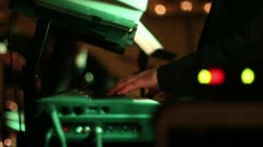 Man playing keyboard at live event with DJ lighting Stock Footage