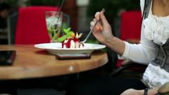 Woman eating tasty panna cotta dessert in cafe HD Stock Footage