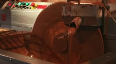 Chocolate making equipment with flowing cocoa Stock Footage