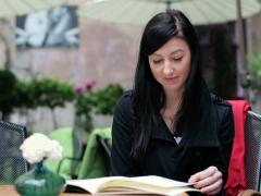 Young woman reading menu in restaurant NTSC Stock Footage