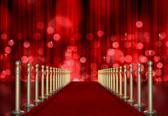 red carpet entrance with the stanchions and the ropes. red light burst over c - stock illustration