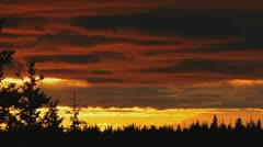 Resplendent Cloudy Mountain Sunset with Trees Stock Footage