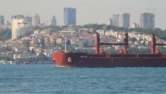 Bulk carrier ship sails through Bosporus waters Stock Footage