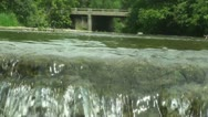 Stock Video Footage of Waterfall on the stream and bridge