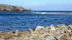 Stony beach in Delos island Greece Stock Footage