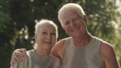 Portrait of elderly couple after fitness in park - stock footage