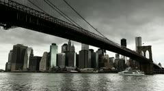 Dark clouds hanging over New York City downtown Brooklyn Bridge Stock Footage