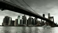 Stock Video Footage of Dark clouds hanging over New York City downtown Brooklyn Bridge