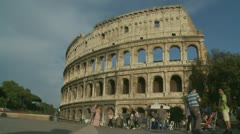 Business man walks towards Colosseum in Rome Stock Footage