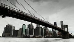 Dark clouds over Manhattan Brooklyn Bridge New York City tilt down 25P PAL Stock Footage
