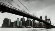 Stock Video Footage of Dark clouds over Manhattan Brooklyn Bridge New York City tilt down 25P PAL