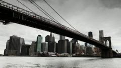 Stock Video Footage of Dark clouds over Manhattan Brooklyn Bridge New York City tilt down 24P