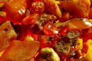 Background from stones of amber Stock Photos