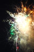 Colorful fireworks on black background Stock Photos