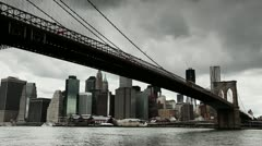 Dark clouds moving in over New York City downtown Brooklyn Bridge timelapse Stock Footage