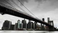 Dark clouds over Manhattan Brooklyn Bridge New York City tilt down - stock footage