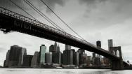 Dark clouds over Manhattan Brooklyn Bridge New York City tilt down Stock Footage